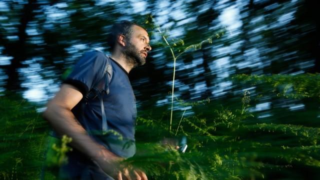 man running in wilderness