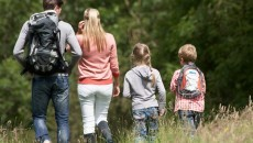 family hiking and in the field