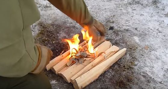 setting up a fire during the winter