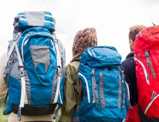 three people wearing backpacks