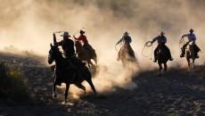 cowboys on horseback