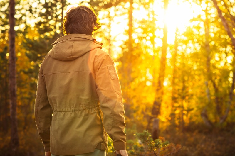 man standing in wilderness
