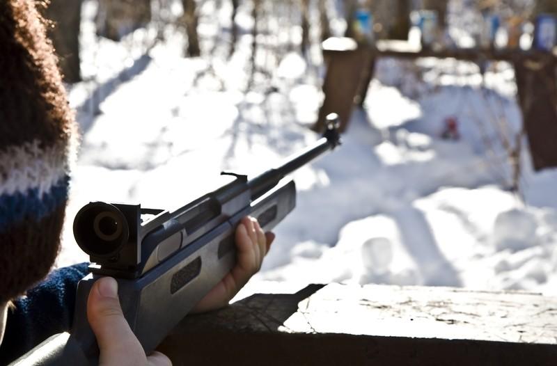 shooting a gun during the winter