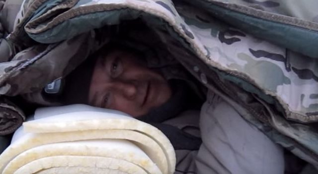 man-surviving-in-blankets
