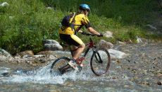 mountain-biker-in-creek