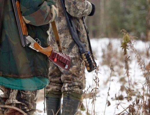 hunter with rifle bushcraft