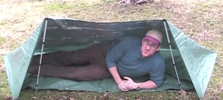 guy in tarp tent