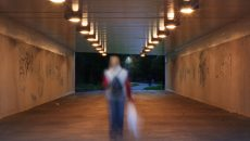 person in a dark alley
