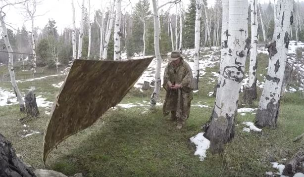 man setting up tarp