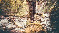 man walking across river
