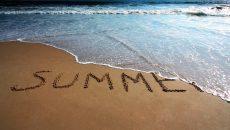 summer written in the sand beach