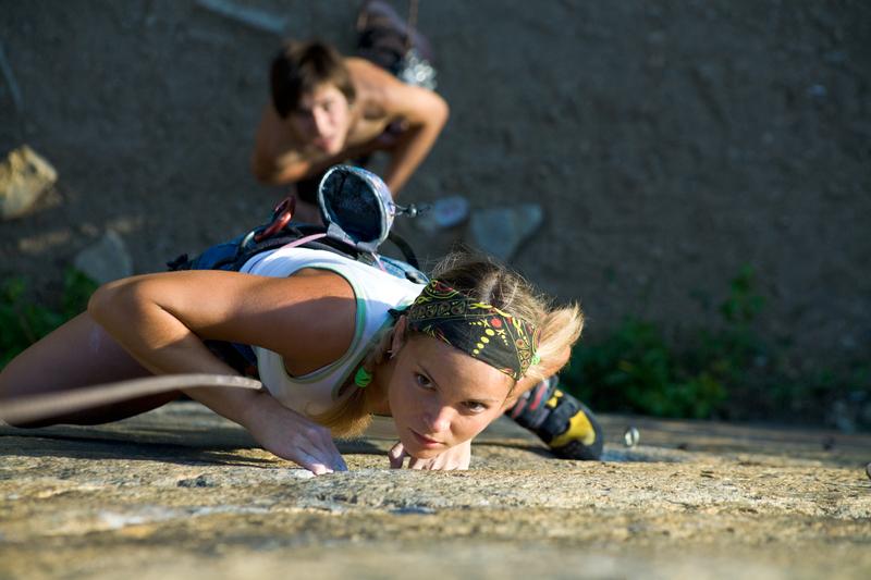 woman and man rock climbing