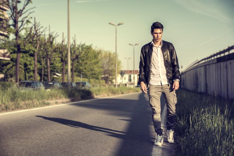 man walking on emptry street