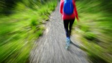 blurred woman hiking in wild
