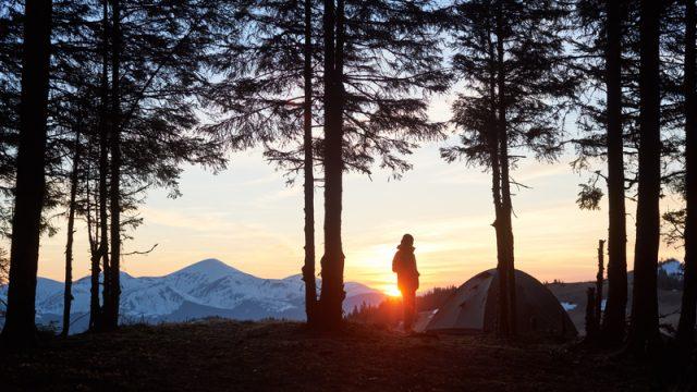 man at sunset camping
